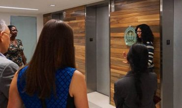 Professionals talking in lobby of U.S. Green Building Council headquarters - 2030 Challenge