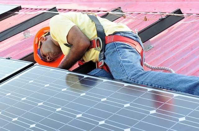Installing solar panels on a house roof