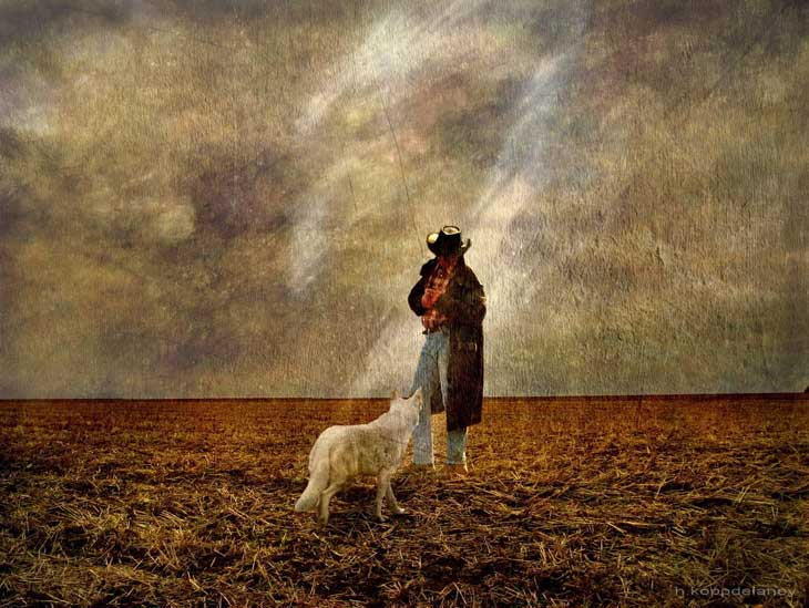 Farmer and dog on soil