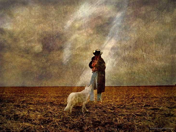 Farmer and dog on soil