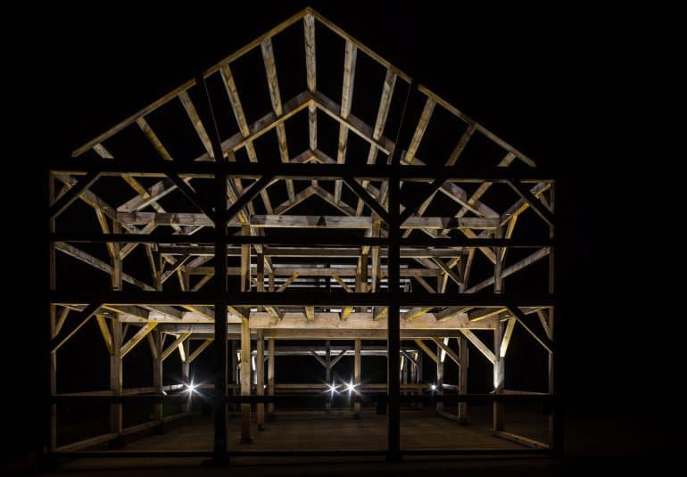 Frame of a house at night - How to save money and energy with advanced framing