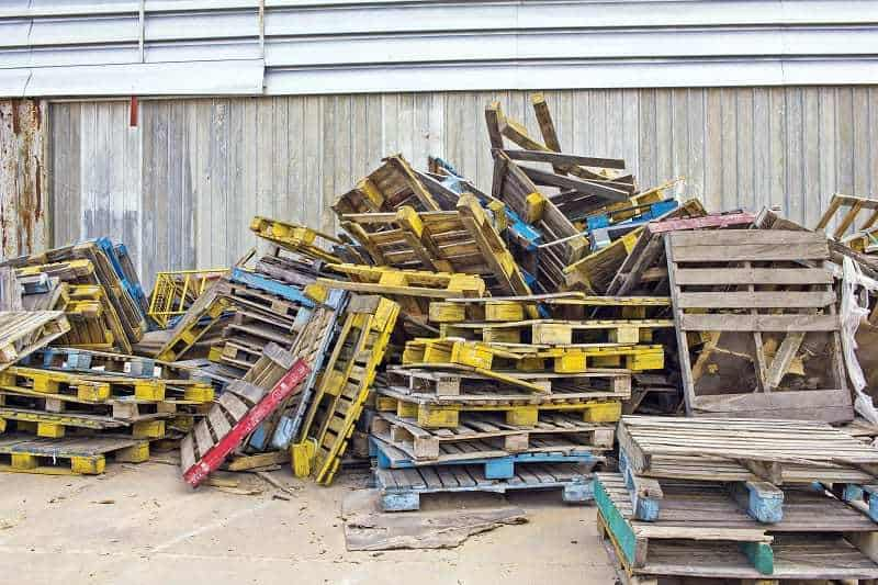 Stack of discarded coloured pallets - DIY platform bed