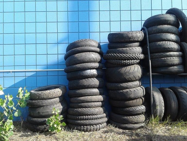 Bunch of recycled tires - How to make a low-cost ottoman with a recycled tire