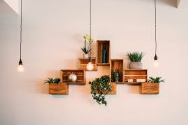 Recycled crates hanging from wall as shelving - Green lighting