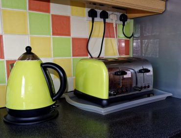 Kettle and toaster in kitchen - Be good to your gadgets