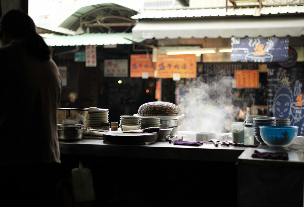Cooking pots in restaurant kitchen. Photo by Cater Yang on Unsplash