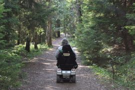 Senior woman on motorized scooter - 4 easy eco-friendly tips for seniors to follow