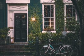 House with bicycle in front - How to know if a fixed-rate mortgage is right for you