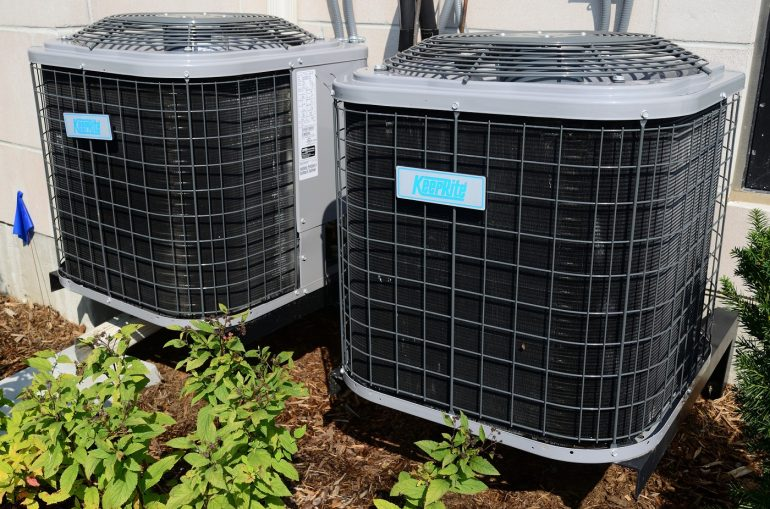 Two air conditioner units - 5 home maintenance tips for a greener property