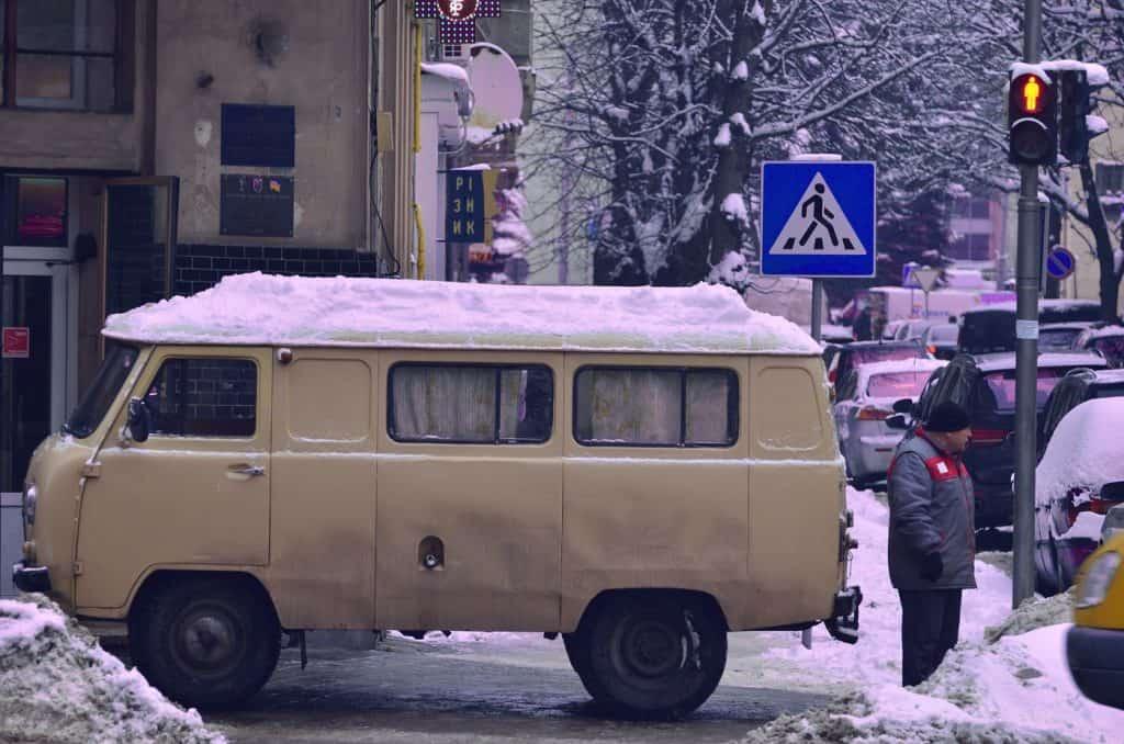 Converted van home on street in winter. Photo from Viktor Talashuk via Unsplash.