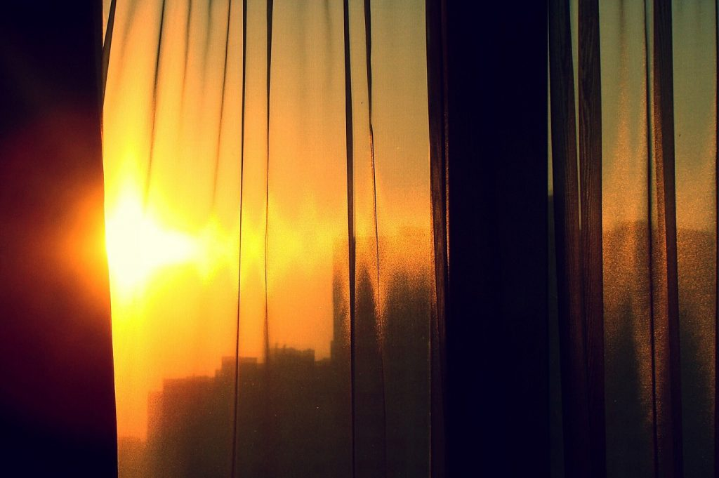 Curtain with sun shining in via Pixabay