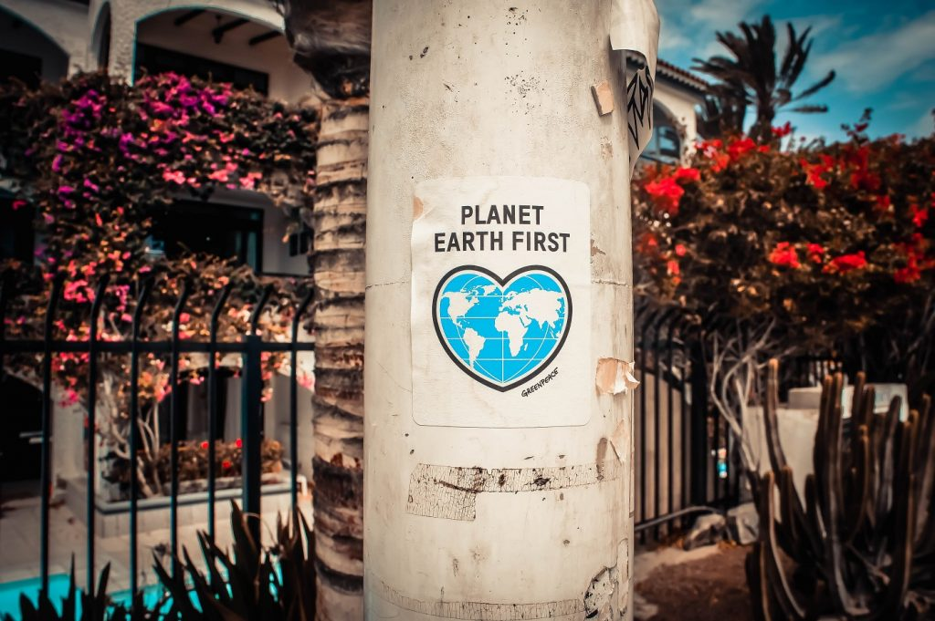 Planet Earth First sign from Gem & Lauris RK via Unsplash