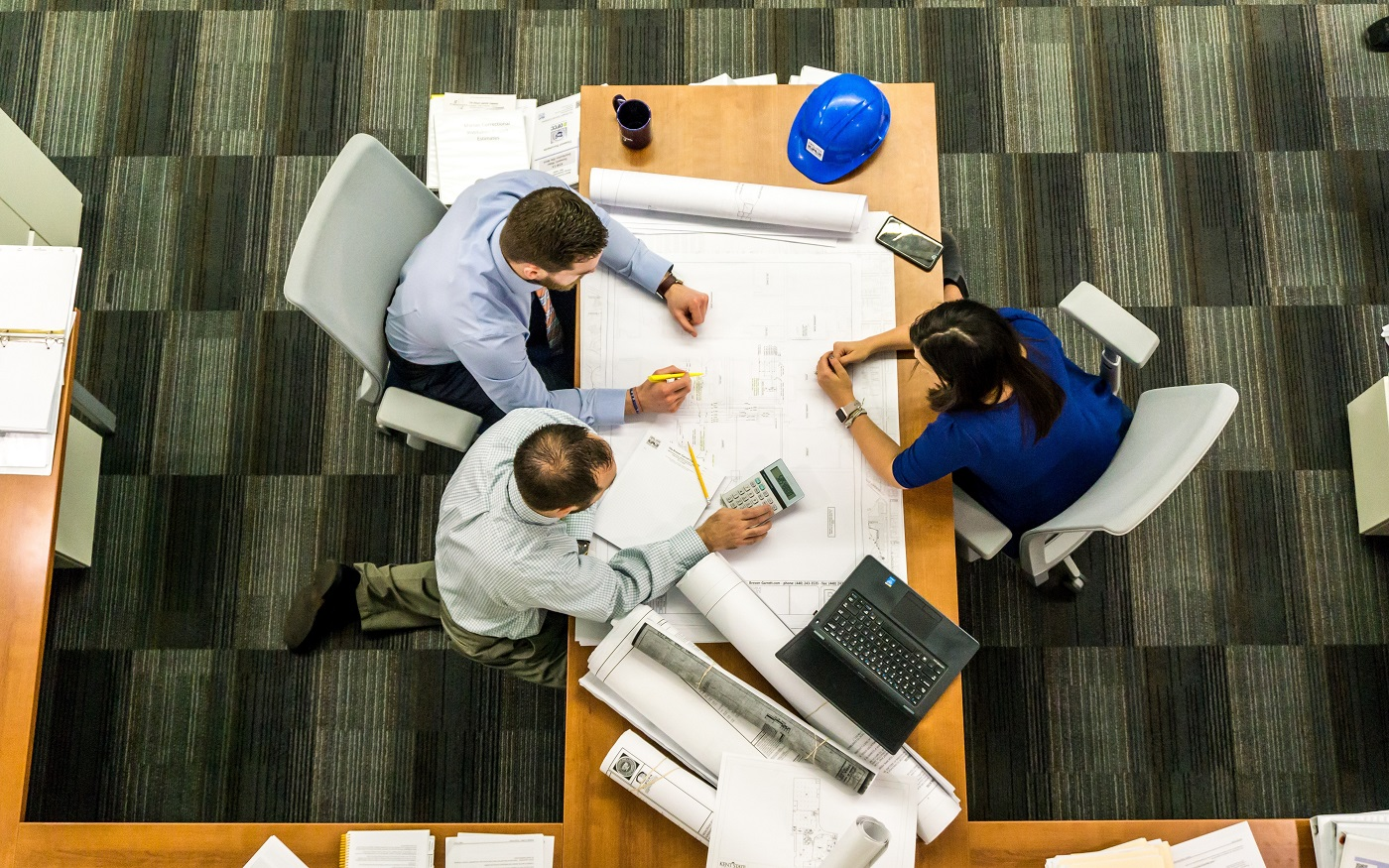 Three architects collaborating at table. Photo from Pexels.