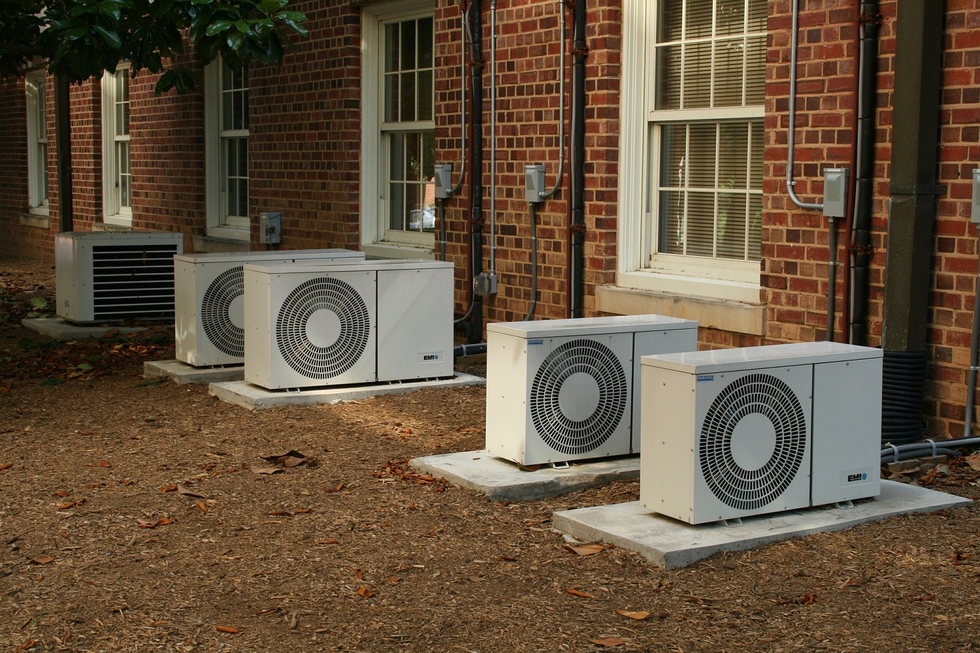 Air conditioning units outside row of homes. Photo from Pixabay.