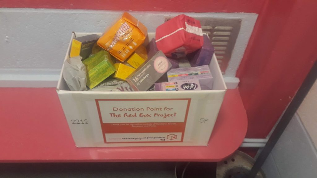 Donated pads and other toiletries in a box. Photo from Wikimedia Commons.