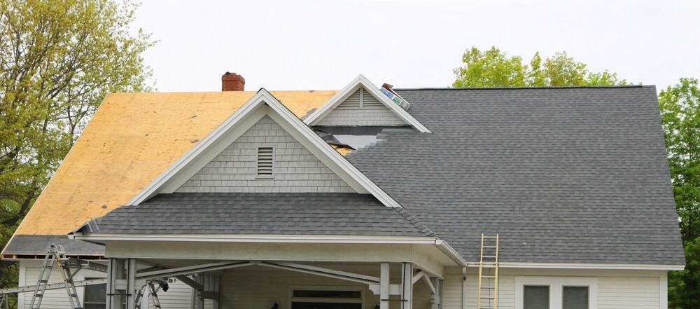 Half-finished roofing job. Photo from Shutterstock.
