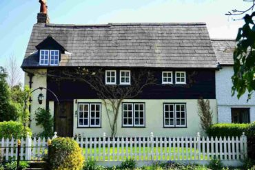 black and white house - add value to your home with green home renovations