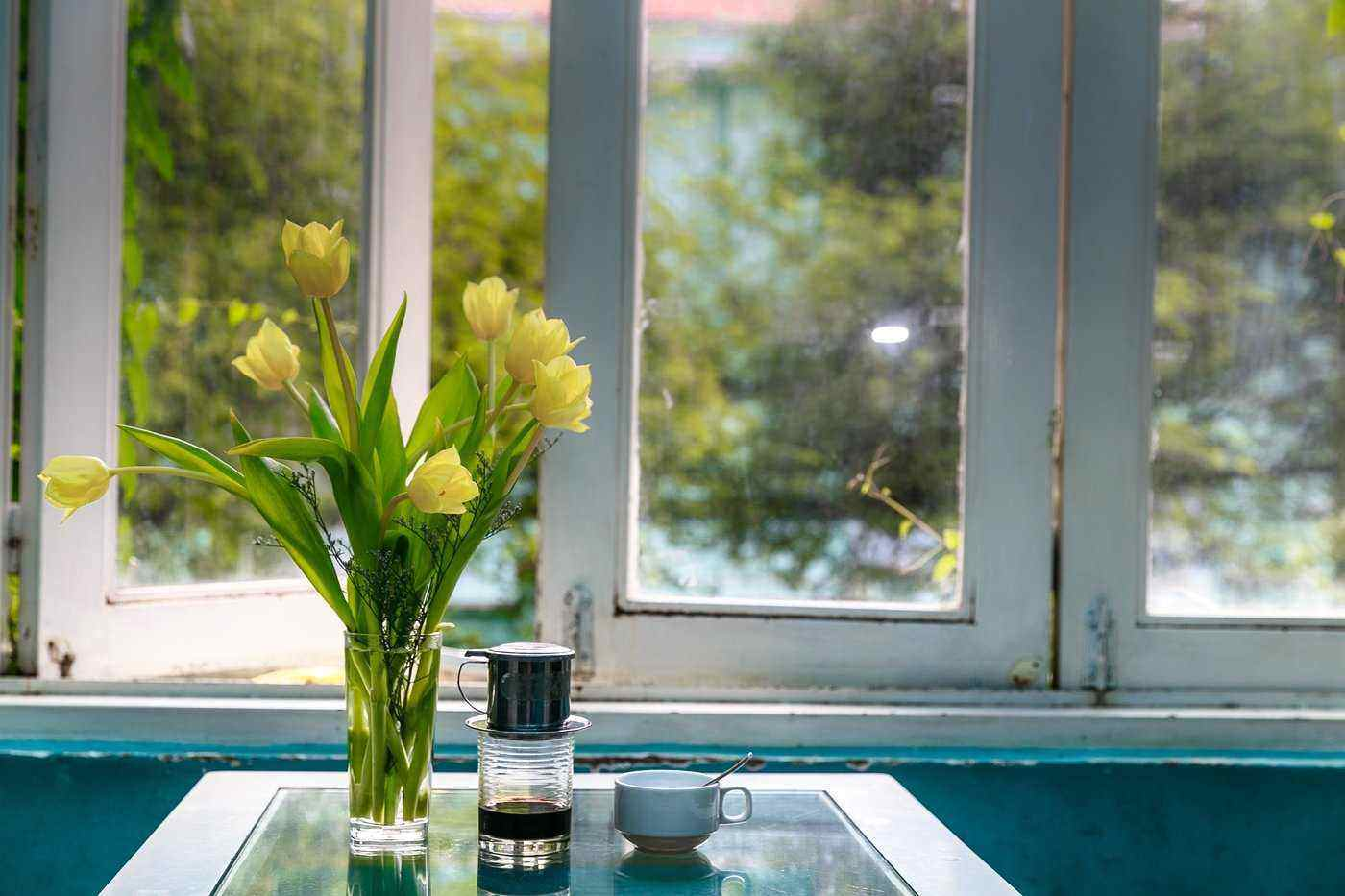 flowers by open window - upgrade windows to add value when selling your home