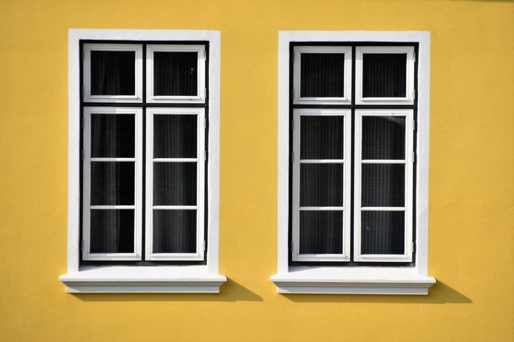 yellow wall with white windows - which home improvements are worth it
